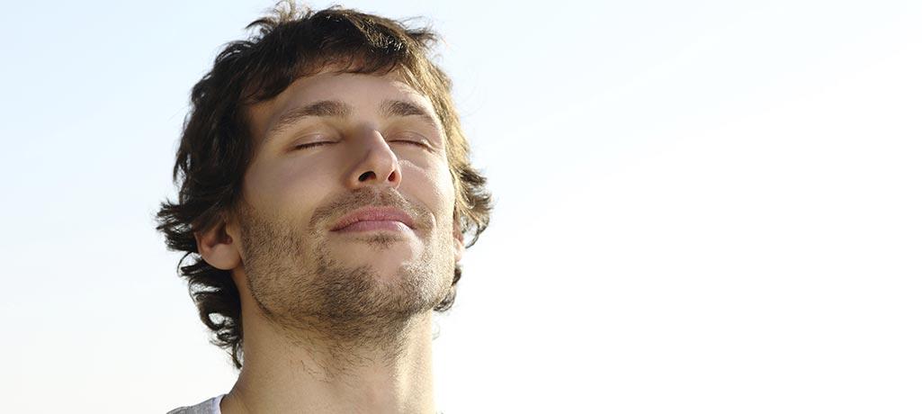 Man meditating with his eyes closed