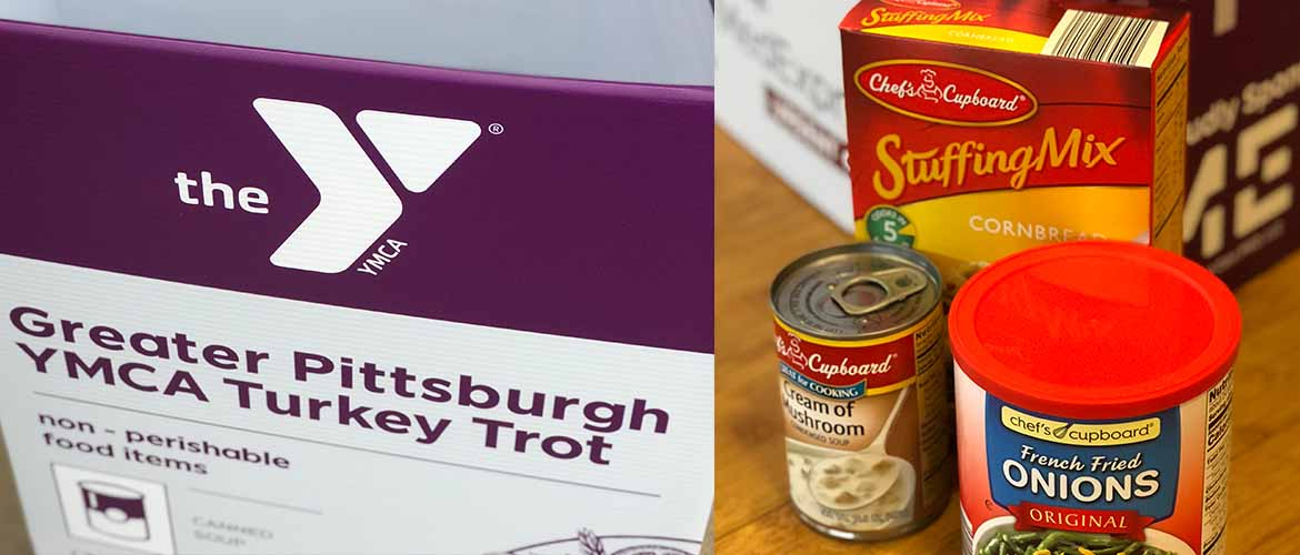 a MedExpress donation box for the YMCA's Greater Pittsburgh Community Food Bank collection along with some donated items, including stuffing mix and cream of mushroom soup