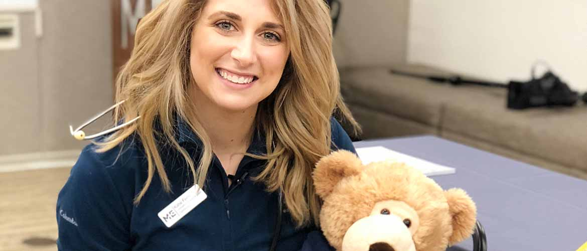 MedExpress Community Involvement and Growth Coordinator Katie Ferri holding a Sniffle teddy