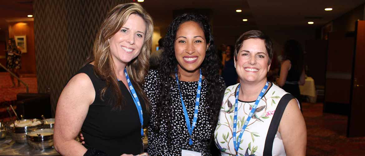 Arlene Neal with two other MedExpress employees at a conference
