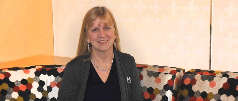 Dr. Dena Nader smiling.