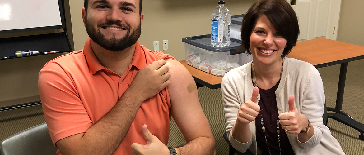 man and nurse with thumbs up after flu shot