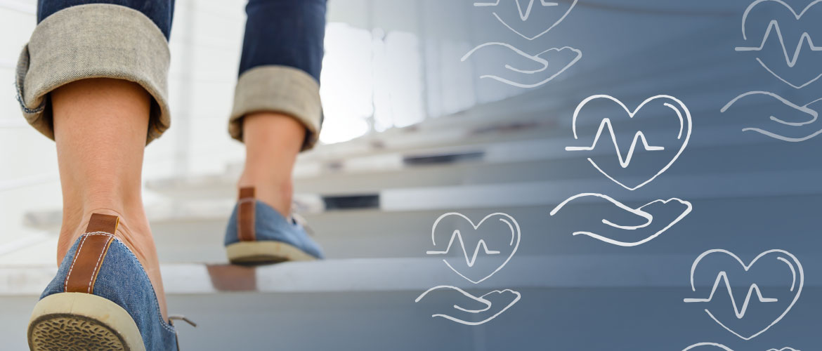 close-up of a person's shoes walking up a set of stairs with a hand underneath a heart icon overlaid on the image
