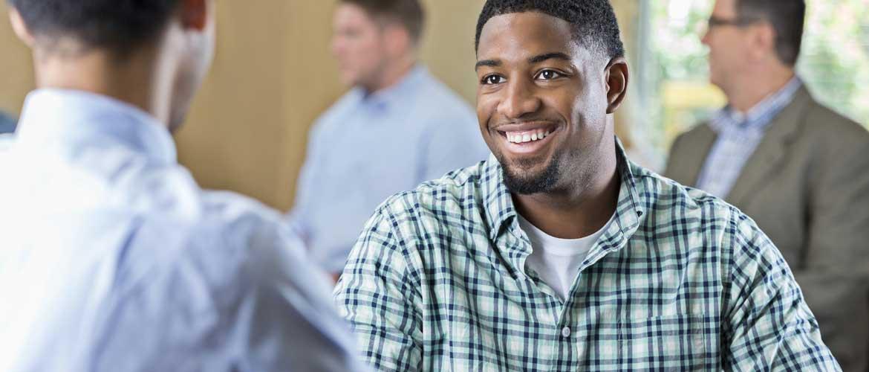 Man smiling at his recruiter.