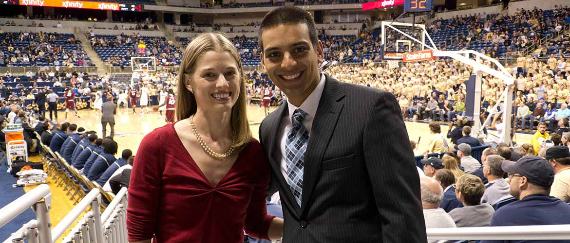 Doctor Adam Abdulally and his wife at a University of Pittsburgh basketball game