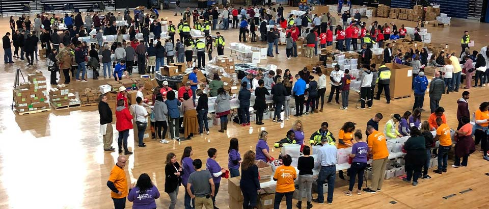 dozens of volunteers putting together care packages at Operation Gratitude's event in Washington D.C.