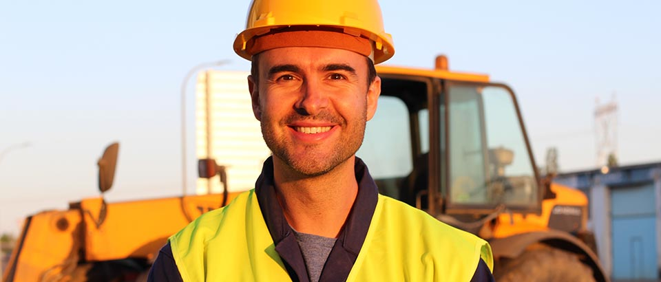 a man wearing a hard hat at a construction site
