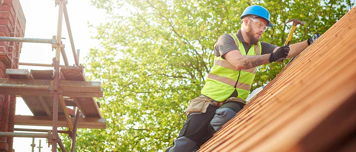 a construction worker repairing a roof