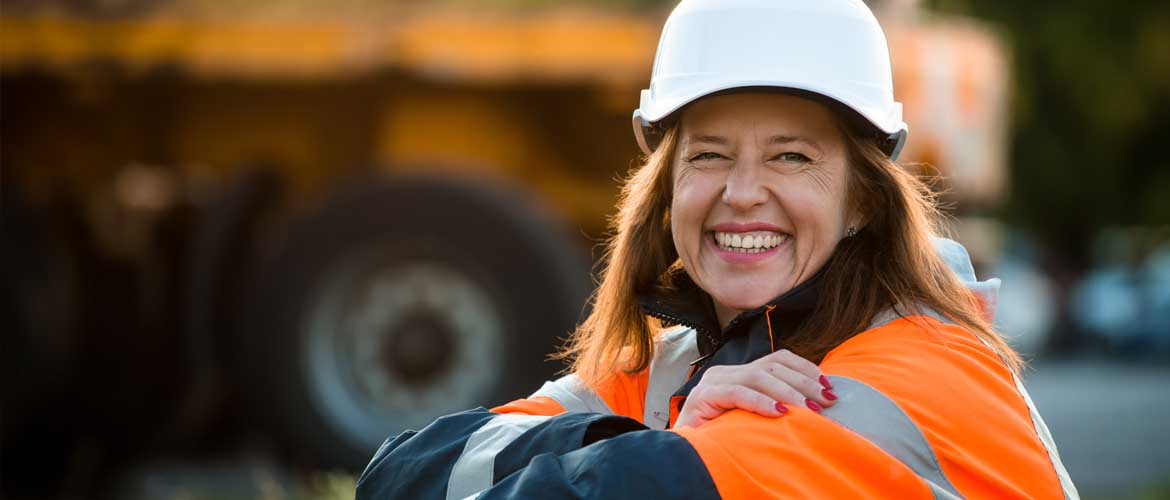 woman in hard hat smiling