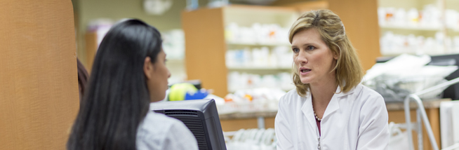 Pharmacy workers having a discussion