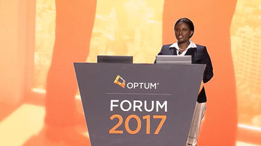 Woman speaking behind the Forum 2017 podium