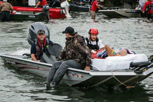 hurricane victims being rescued by motor boat