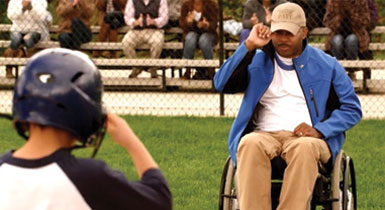 paralyzed veteran on a baseball field