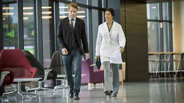 Doctor and employee walking down a hallway