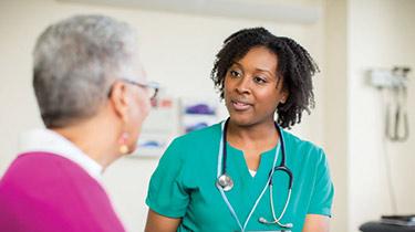 nurse and patient talking