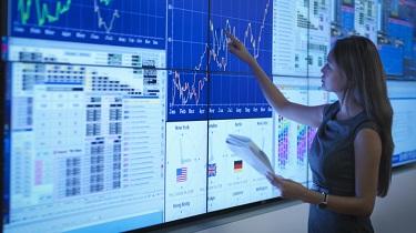 Woman analyzing data on a large screen