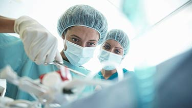 Surgeon working in the operating room