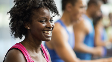 African american woman in a gym smiling