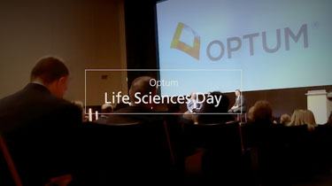 Crowded auditorium with text overlay that reads 'Optum Life Sciences Day'