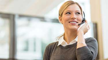 Woman in a call center, talking on a headset