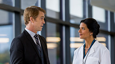 Doctor and business person talking